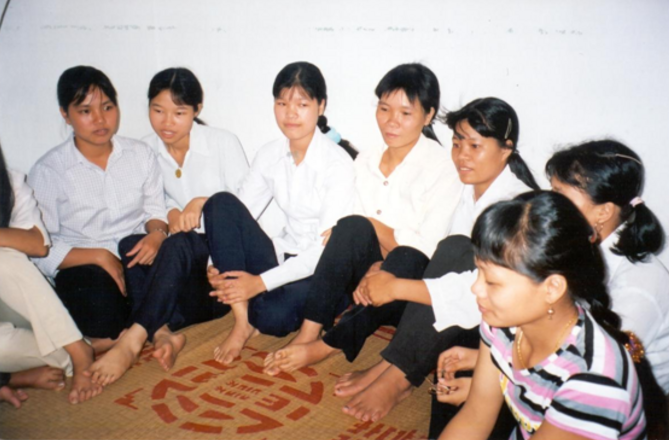 Women factory workers relax after work