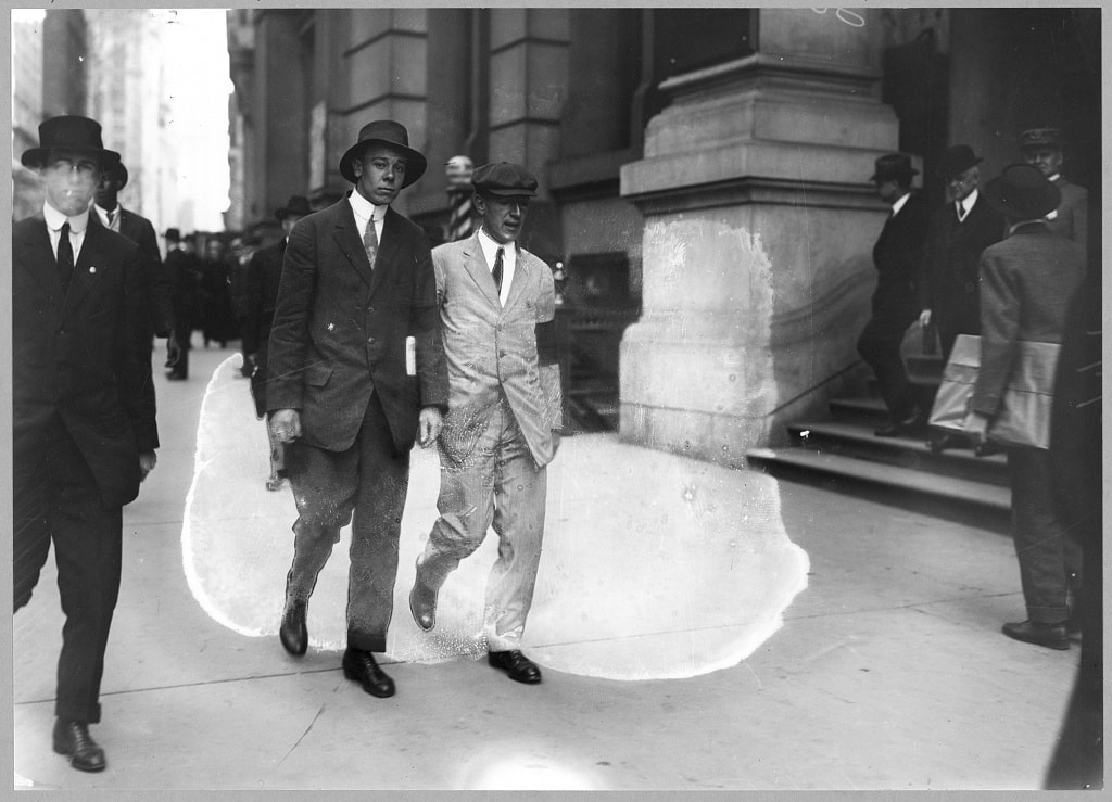 Upton Sinclair, in white suit with black arm band, picketing Rockefeller Building