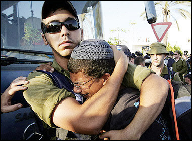 A Soldier Comforts a Settler in Gaza