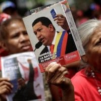 Supporters of President Nicolas Maduro rally to support him while carrying pictures of late Venezuela's President Hugo Chavez, in Caracas, Venezuela, May 8, 2017.