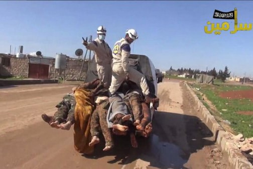 | White Helmets workers posing with the bodies of dead Syrian soldiers | MR Online
