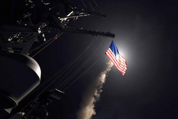 In this image provided by the U.S. Navy, the guided-missile destroyer USS Porter (DDG 78) launches a tomahawk land attack missile in the Mediterranean Sea, Friday, April 7, 2017. (Mass Communication Specialist 3rd Class Ford Williams/U.S. Navy via AP).