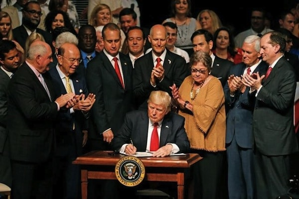 President Donald Trump signing the new Cuba policy