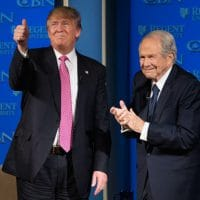 Donald Trump with the Rev. Pat Robertson in 2016 at Virginia's Regent University, founded by Robertson. This month Robertson was granted a White House interview with the president for the Christian Broadcasting Network, also founded by the televangelist. (Steve Helber / AP)