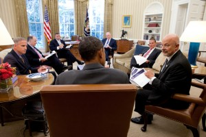 Director of National Intelligence James Clapper (right) talks with President Barack Obama in the Oval Office, with John Brennan and other national security aides present. (Photo credit: Office of Director of National Intelligence)