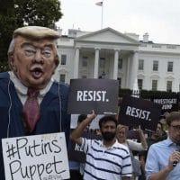 People gather outside the White House on Pennsylvania Avenue in Washington, Tuesday, July 11