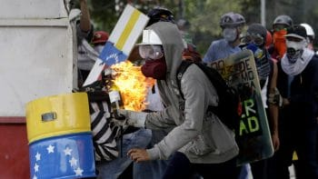 A demonstrators readies a gasoline bomb as he prepares to throw it at the police during clashes between authorities and anti-government demonstrators in Caracas, Venezuela, Wednesday, June 7, 2017. The protest movement has claimed more than 60 lives as it enters its third month. (AP Photo/Fernando Llano)