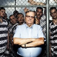 Sheriff Joe Arpaio standing in front of Arizona inmates at Tent City.