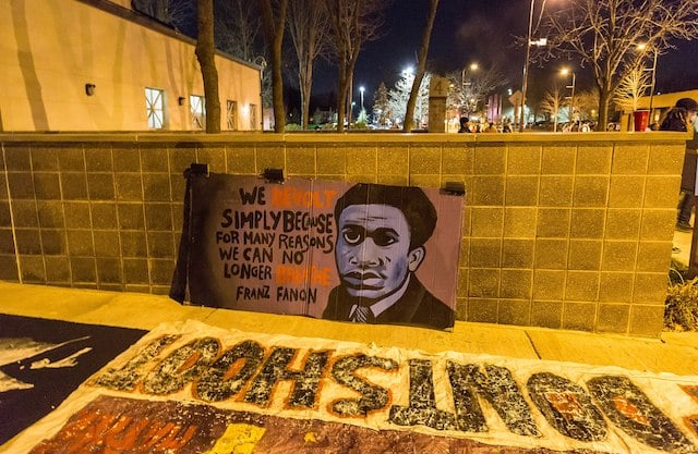 Fanon Banner outside the Minneapolis Police Department fourth precinct following the officer-involved shooting of Jamar Clark on November 15, 2015. Photo: Tony Webster tony@tonywebster.com