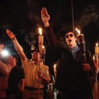"In Charlottesville a ""Unite the Right"" rally was planned and a march was held ahead of it where alt-righters gathered to march with lit tiki torches."