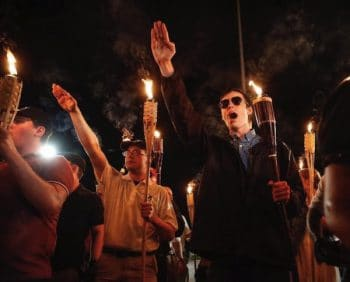 """In Charlottesville a """"Unite the Right"""" rally was planned and a march was held ahead of it where alt-righters gathered to march with lit tiki torches."""