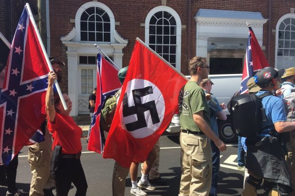 Right-wing protestors flying the Nazi flag along with the the Confederate flag