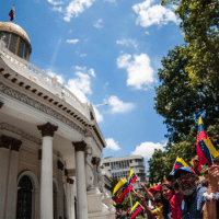 Chavistas gathered around Venezuela's Legislative Palace to witness the return of Simón Bolívar and Hugo Chávez' portraits