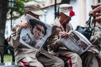 Members of the Bolivarian Militia read Ciudad Caracas newspaper, while waiting for the Constituent Assembly installation