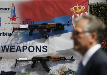 A visitor looks at assault rifles made by the Serbian company Zastava Arms, during a defense fair, in Belgrade, Serbia. (AP/Darko Vojinovic)