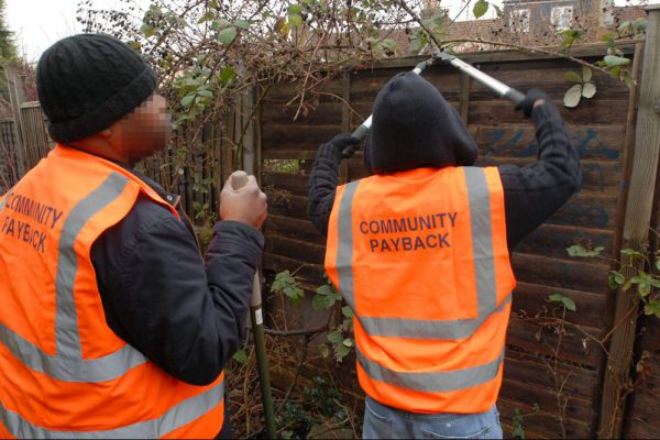 Two men sentenced to perform unpaid community work wearing tabards emblazoned with 'Community Payback' to make their punishment visible