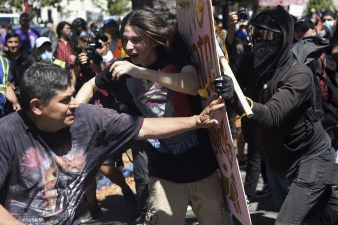| Antifascists push back against a fascist protestor with a Pinochet Tshirt | MR Online