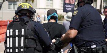 Activist being handcuffed in Berkley antifa protests