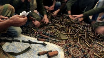 Free Syrian Army militants clean their weapons and check ammunition at their base on the outskirts of Aleppo, Syria. (Khalil Hamra/AP)