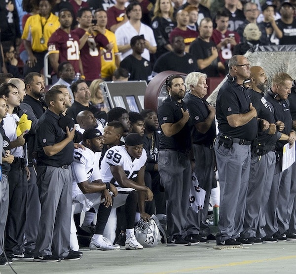 Oakland Raiders teammates kneel during the national anthem, Sep. 24, 2017