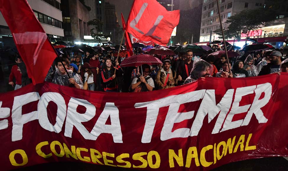 "People protest with the slogan ""Fora Temer"" (Out with Temer) / Photo credit: The Week"