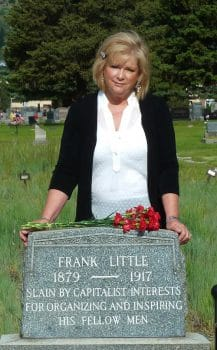 Jane Botkin poses at Frank Little's grave