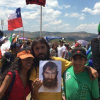 People hold a picture of Santiago Maldonado, Argentinian activist kidnapped and disappeared by the government last August.