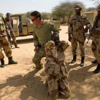US Special Forces soldier trains Niger troops. (photo Credit: Reuters)