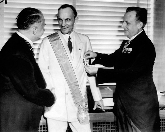Ford receiving the Grand Cross of the German Eagle from Nazi officials, 1938