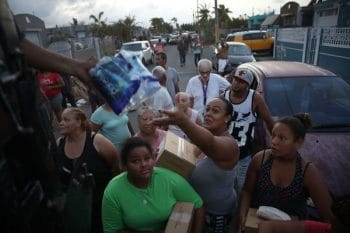Hurricane Maria survivors receive food and water .