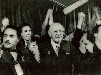 W. E. B. Du Bois and others with hands linked and raised at the Afro-Asian Writers Conference in Tashkent in October 1958. W. E. B. Du Bois Papers (MS 312). Special Collections and University Archives, University of Massachusetts Amherst Libraries.