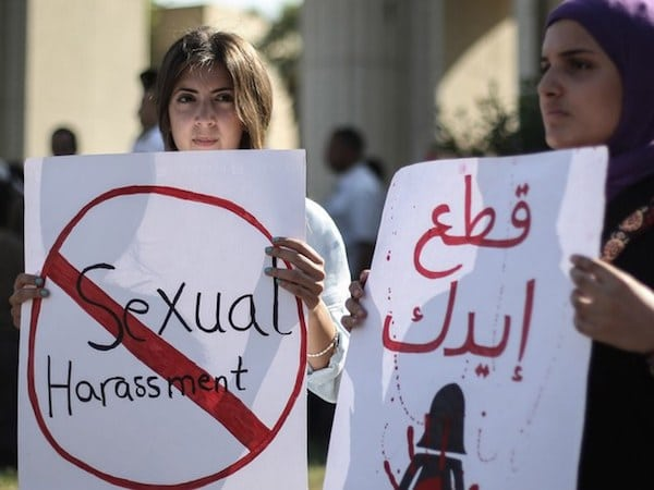 | Ladies holding signs against sexual harassment | MR Online