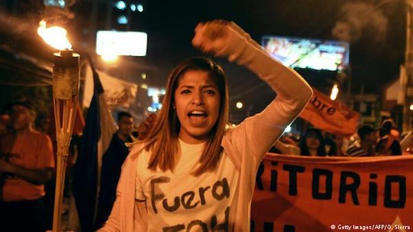Girl in protest. Photo Credit: Deutsche Welle