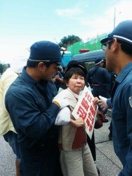 A women taken away at a protest. Photo: Eliza Egret