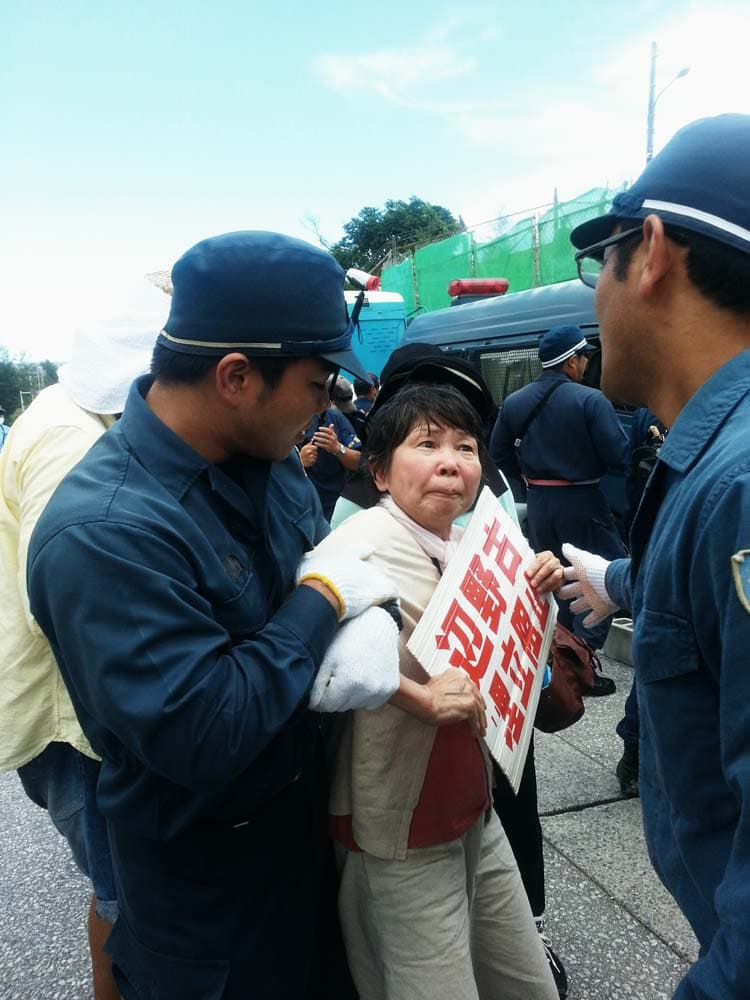 A women taken away at a protest. Photo: Eliza Egret