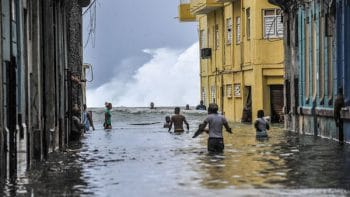 Habaneros wade through floodwaters near El Malecón after Hurricane Irma. YAMIL LAGE/AFP/GETTY IMAGES