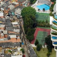A shantytown in São Paulo, Brazil, borders the much more affluent Morumbi district. Credit: Tuca Vieira / Oxfam