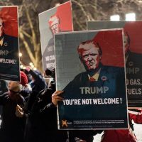 Demonstrators in Zurich this week. While many are poised to recoil at President Trump's arrival in Davos this week, much of the moneyed elite there are willing to overlook what they portray as the president's rhetorical foibles in favor of the additional wealth he has delivered to their coffers. (Ennio Leanza/European Pressphoto Agency)
