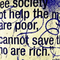 """""""If a free society cannot help the many who are poor, it cannot save the few who are rich."""" -- John F. Kennedy © mSeattle   Flickr"""