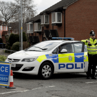 Police officers stand guard at the bottom of the road where former Russian double agent Sergei Skripal lives in Salisbury, England