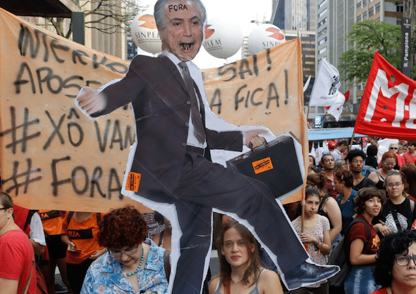 FACT NOT FAKE: Demonstrators protest against pension reforms proposed by the government and holding an cutout of President Michel Temer, 10 days ago