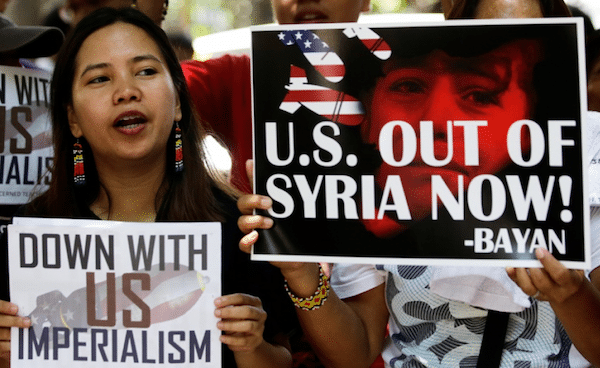 A demonstration against the US air raids on Syria in the Philippines. China's report states that the US has committed acts of aggression against Syria four times in recent months