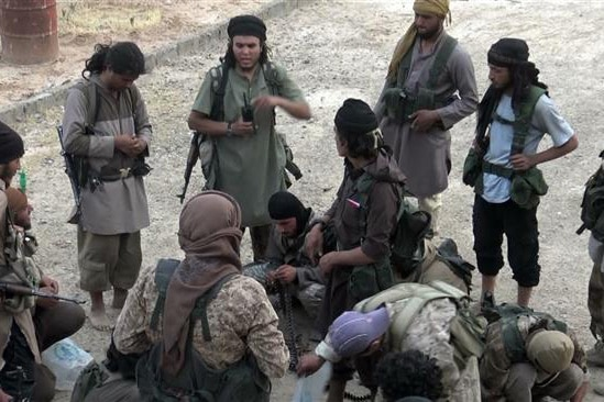 Daesh Takfiri militants at an unknown location in Syria