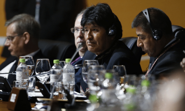 Bolivia's President Evo Morales (second right) attends the plenary session at the Americas Summit in Lima, Peru