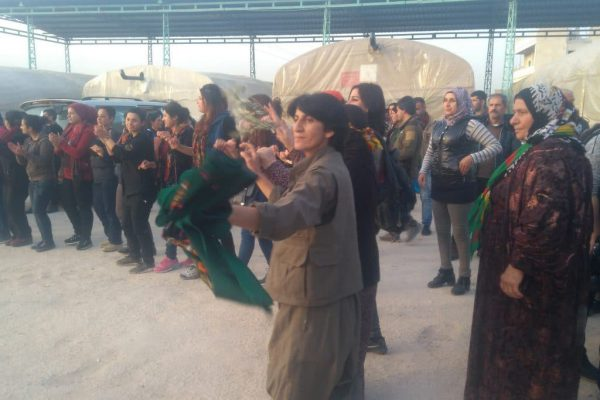 Fighters and women dancing in the street of Afrin