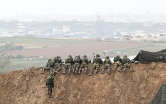 Israeli forces, prepared to shoot Palestinian protesters in Gaza.