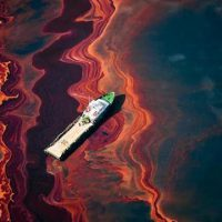 Oil spill around ship.