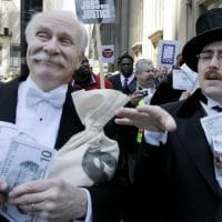 Protesters, dressed as wall street bankers, march from Goldman Sachs' office to a rally in Federal Plaza demanding Wall Street reform, Wednesday, April 28, 2010, in Chicago. (AP Photo/M. Spencer Green)