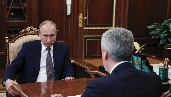 Vladimir Putin (L) and Moscow Mayor, Sergei Sobyanin