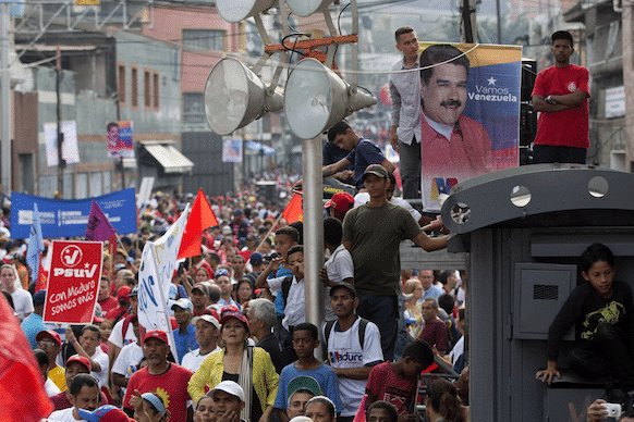 Supporters of President Nicolas Maduro attend a campaign rally in the parish of Catia in Caracas, Venezuela, Friday, May 4, 2018. Venezuelans will vote for a new president in the upcoming presidential elections on May 20. (AP/Ariana Cubillos)